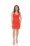 Teen girl wearing orange dress. On white background Royalty Free Stock Photography
