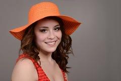 Teen girl wearing orange hat Royalty Free Stock Images