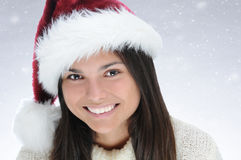 Teen Girl Wearing Santa Hat Royalty Free Stock Photography