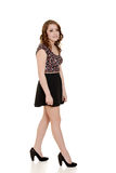 Teen girl wearing short black skirt Stock Image
