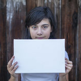 Teen girl with a white banner in the hands Royalty Free Stock Images