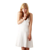 Teen girl in white dress. Young beautiful blond teen girl in white dress isolated Stock Photo