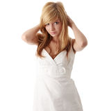 Teen girl in white dress Stock Images