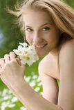 Teen girl with white flowers in park Royalty Free Stock Photo