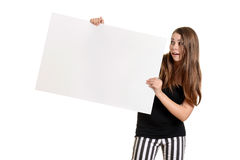 Teen girl with white large white card Royalty Free Stock Photos
