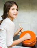 Teen Girl With Pan Stock Photography