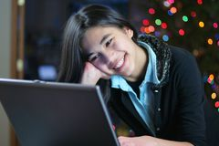 Teen girl working on the laptop Stock Photo