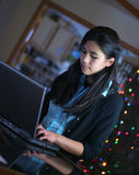 Teen girl working on laptop royalty free stock images
