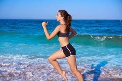 Teen girl workout running in beach shore stock photos