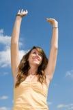 Teen Girl Worship. Beautiful teen girl raising her arms in praise or worship.  Vertical view Royalty Free Stock Images