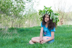 Teen girl with  wreath of cherry blossoms on her head Royalty Free Stock Image