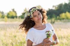 Teen girl with  wreath of daisies Stock Photos