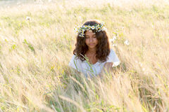 Teen girl with  wreath of daisies Royalty Free Stock Image