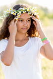 Teen girl with  wreath of daisies Stock Image