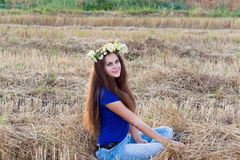 Teen girl with a wreath of daisies Stock Photography