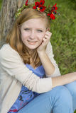 Teen girl with a wreath of spring flowers Royalty Free Stock Photography