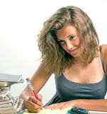 Teen girl writing Royalty Free Stock Images