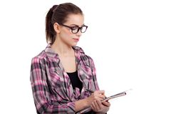 Teen girl writing Stock Photography