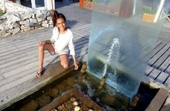 Teen girl 11 years with a fountain in a spa Stock Images