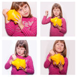 Teen girl with yellow monebox Royalty Free Stock Photos