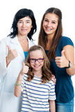 Teen girl and younger sister with dentist. Stock Images