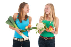 Teen girlfriends with fresh vegetables and fruit Royalty Free Stock Photo