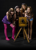 Teen girls and antique camera Royalty Free Stock Photos