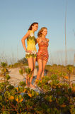 Teen girls at beach. Two teen girls at the beach standing on a sand dune Royalty Free Stock Photography