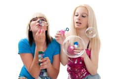 Teen girls blowing bubbles Royalty Free Stock Photos