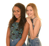 Teen girls in blue jeans Stock Images