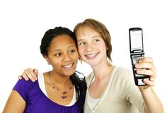 Teen girls with camera phone. Isolated portrait of two teenage girls with camera phone Royalty Free Stock Photo