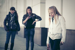 Teen girls with a cell phones on the street Stock Images