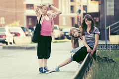 Teen girls in a city street Stock Photo