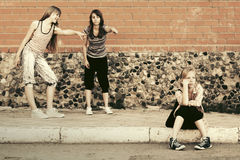 Teen girls in conflict at the school building. Group of teen girls in conflict at the school building Royalty Free Stock Images