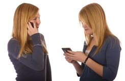 Teen girls each on a cell phone stock images