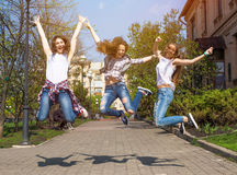 Teen girls enjoy friendship. Young happy teenagers having fun in summer park. Stock Photography