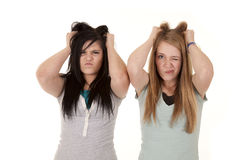 Teen girls frustrated. Two teen girls frustrated and wanting to pull their hair out stock photo