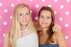 Teen girls. Teen girlfriends on pink background Stock Photo