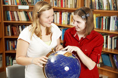 Teen Girls with Globe Royalty Free Stock Images
