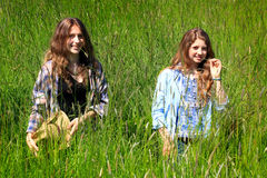 Teen Girls Hanging Out. Two pretty country teen girls with long brown hair, walking in tall grass. Shallow depth of field Stock Image