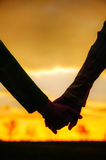 Teen girls holding hands. At sunset time Stock Image