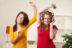 Teen girls listening to music Stock Image