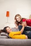Teen girls listening to music at home Stock Photos