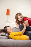 Teen girls listening to music at home royalty free stock images