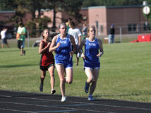 Teen Girls in Long Distance Track Race Royalty Free Stock Photo