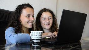 Teen girls looking at laptop Stock Image