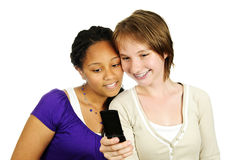 Teen girls with mobile phone. Isolated portrait of two teenage girls with cell phone Royalty Free Stock Images