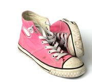 Teen girls pink sneakers. Pair of pink girls sneakers isolated on white Stock Photos