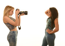 Teen girls playing with camera Royalty Free Stock Photos