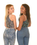 Teen girls posing in blue jeans Stock Images